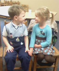 Toddlers holding hands in Sunday School